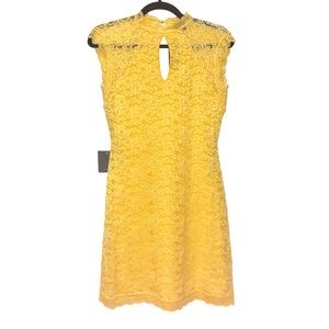 Its a yellow dress from the brand Bebe